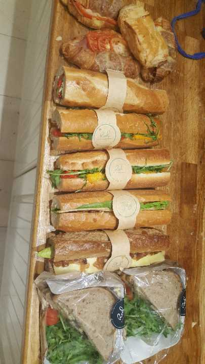 Meat croissants, veggie rolls and veggie sandwiches