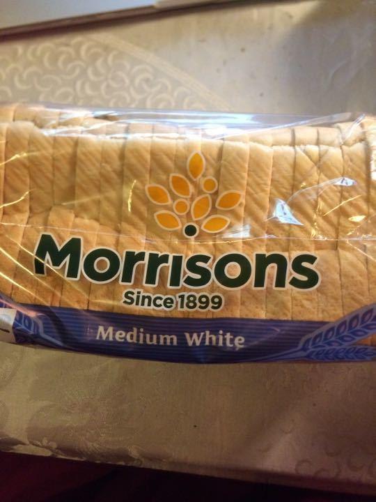 Medium white loaf of sliced bread