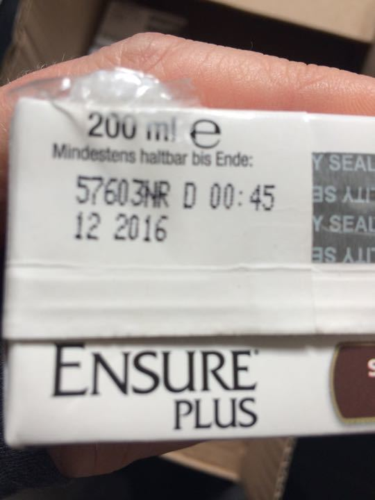 Selection of ensure plus drinks and cream