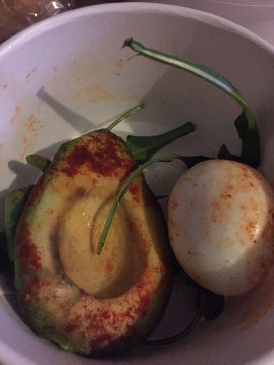 Boiled egg and half avocado