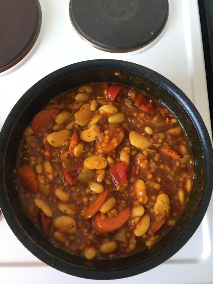 Portion of bean and lentil stew