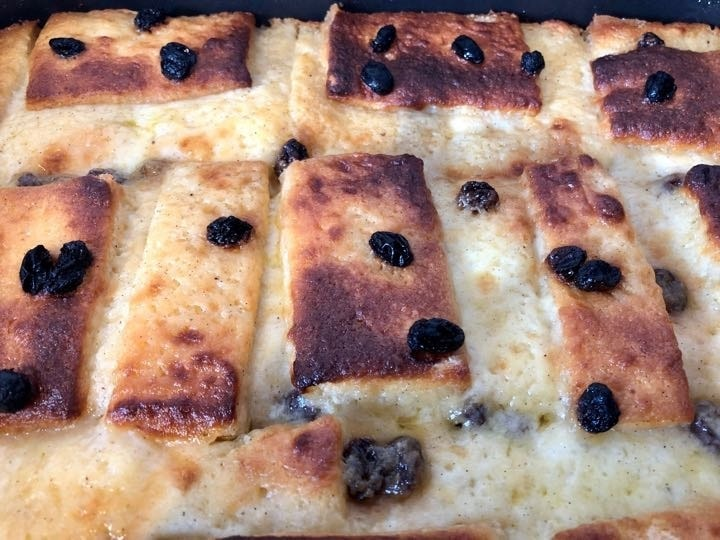 Single portion of homemade bread and butter pudding