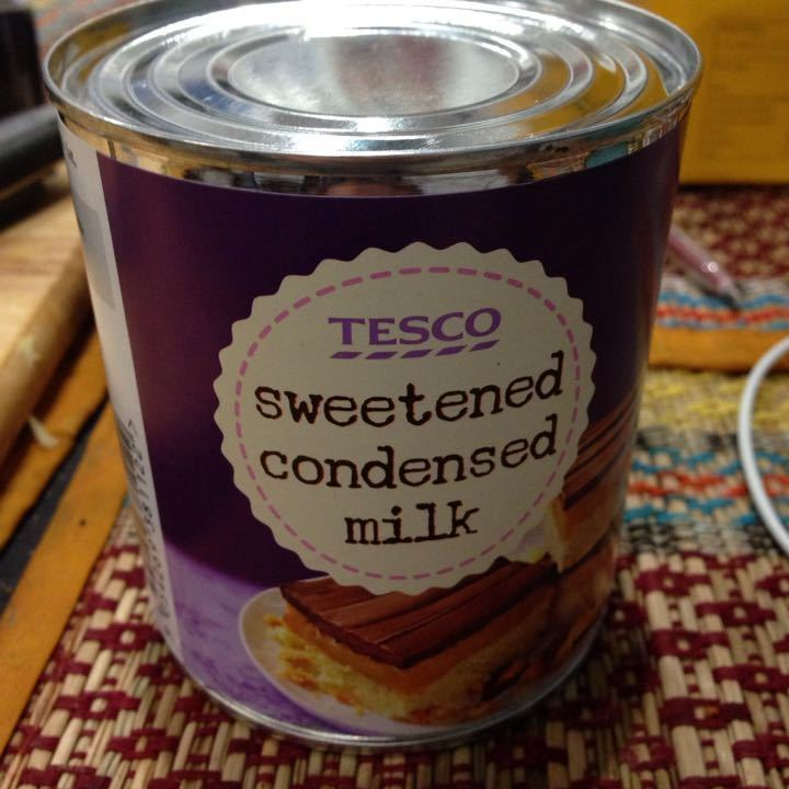 Two cans of condensed milk