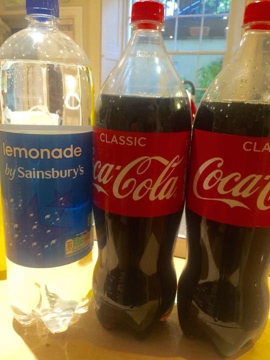 Two 1.75l bottles of Coke and a 2l bottle of lemonade.