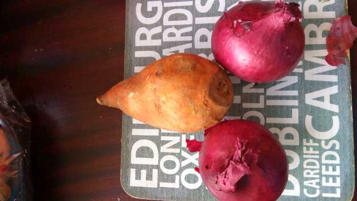 Two red onions one sweet potato