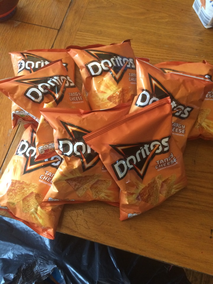 9 packets of tangy cheese Doritos