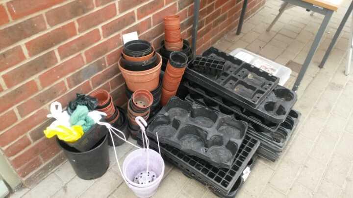 Lots of plastic plant pots