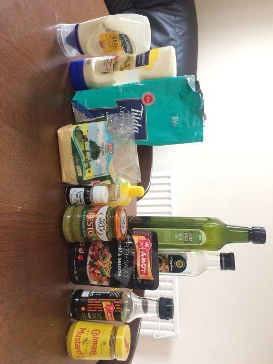 Various non-perishable foods (couscous, rice, mayonaise, oil, vinegar, pesto, soy sauce, mustard...)
