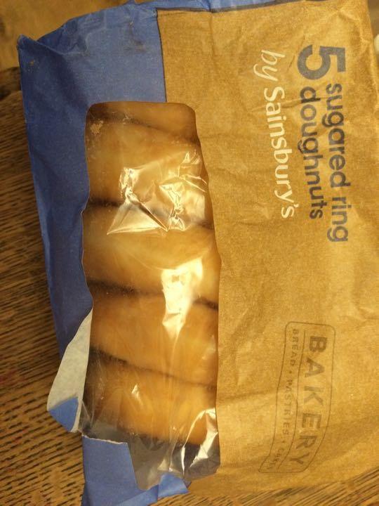 5 sugared ring doughnuts.