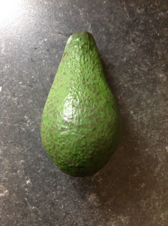Very ripe large green avocado