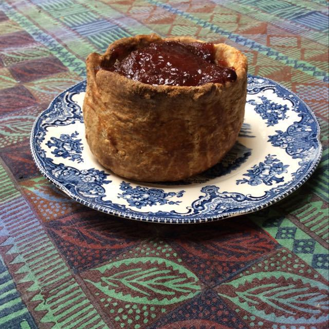 Hand raised pork pie with quince jelly topping