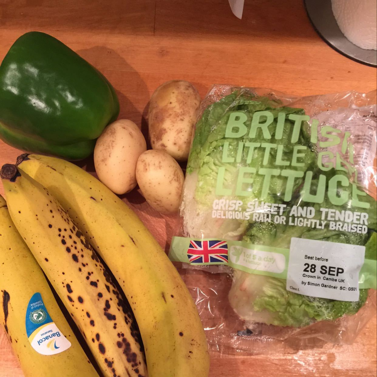 Bananas, gem lettuce, potatoes and a green pepper.