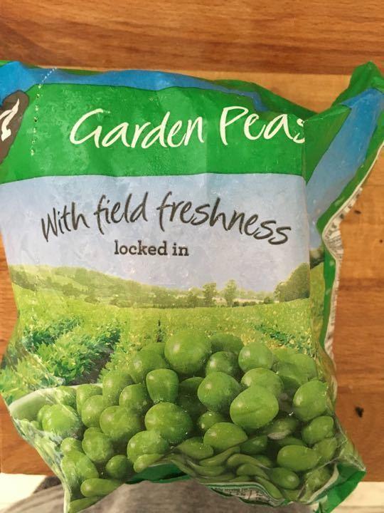 Garden peas unopened and frozen