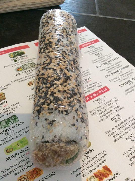 Bento sushi whole roll uncut ( poss spicey tuna or salmon )