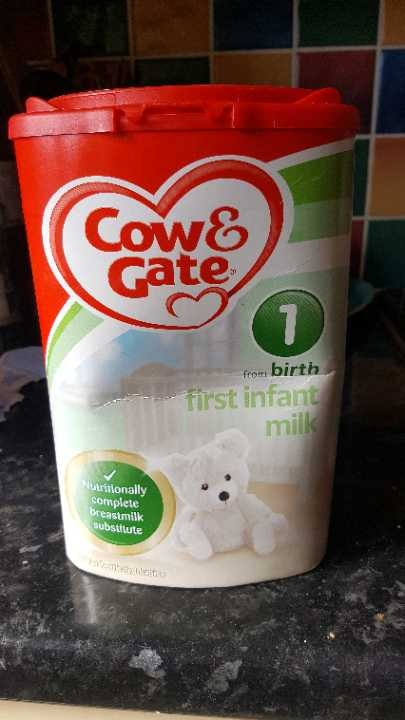 Half a tub of cow and gate first infant milk.