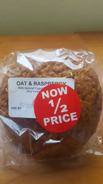 Oat and raspberry muffin with natural yoghurt