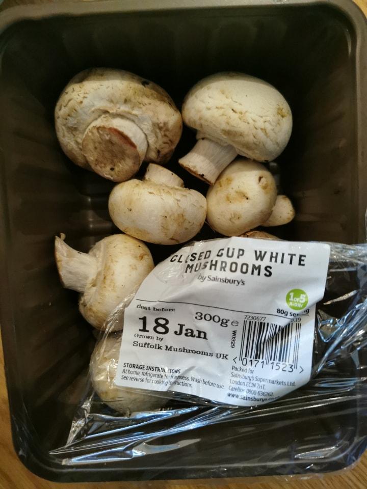 Open punnet of mushrooms