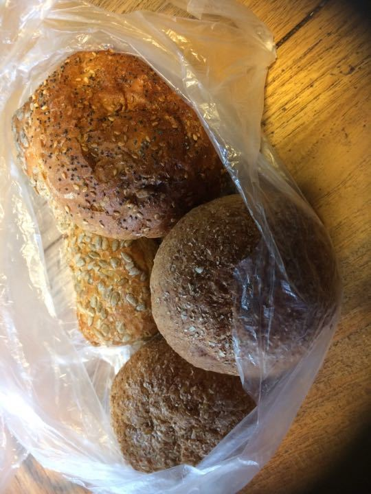 Selection of brown rolls with seeds