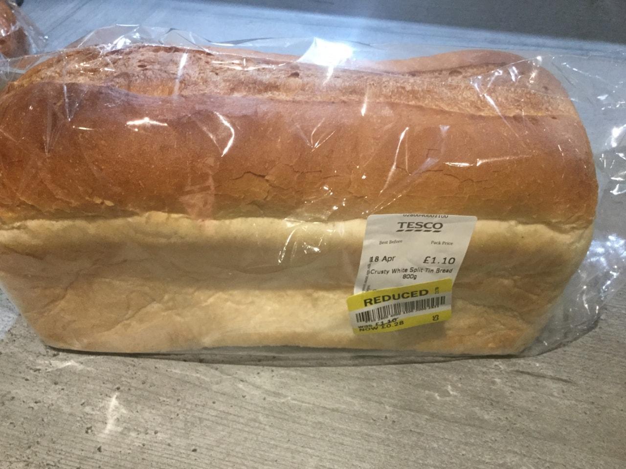Large unsliced white loaf