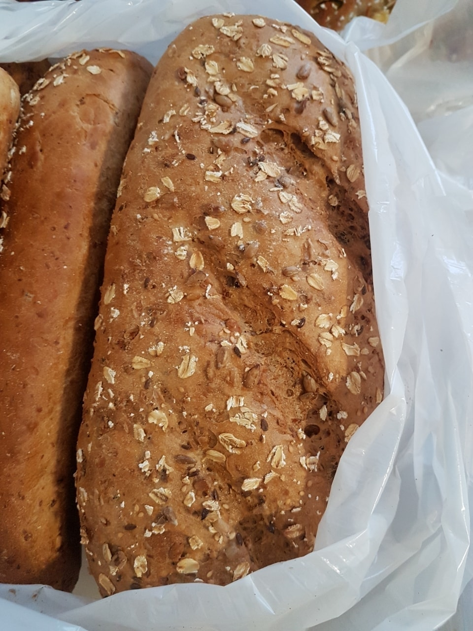 Fresh bread loaf with oats