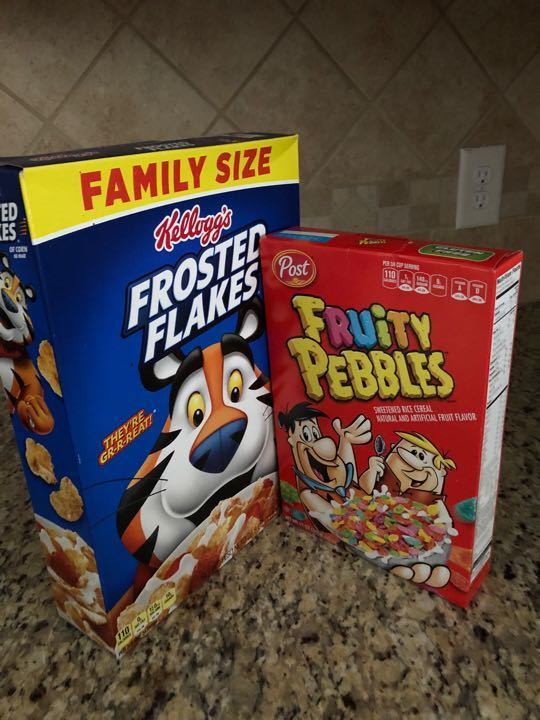 Unopened cereal - Frosted Flakes and Fruity Pebbles