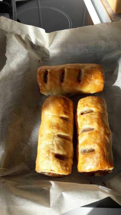 3 freshly baked very meaty sausage rolls.