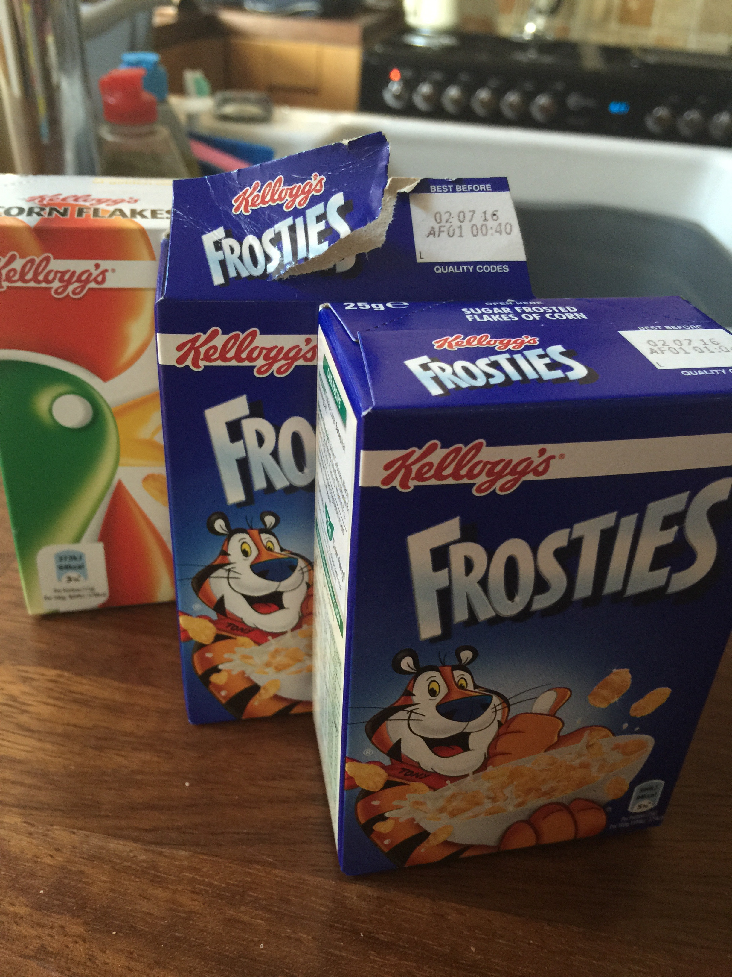 2 singleserve boxes of Frosty's and a Cornflakes