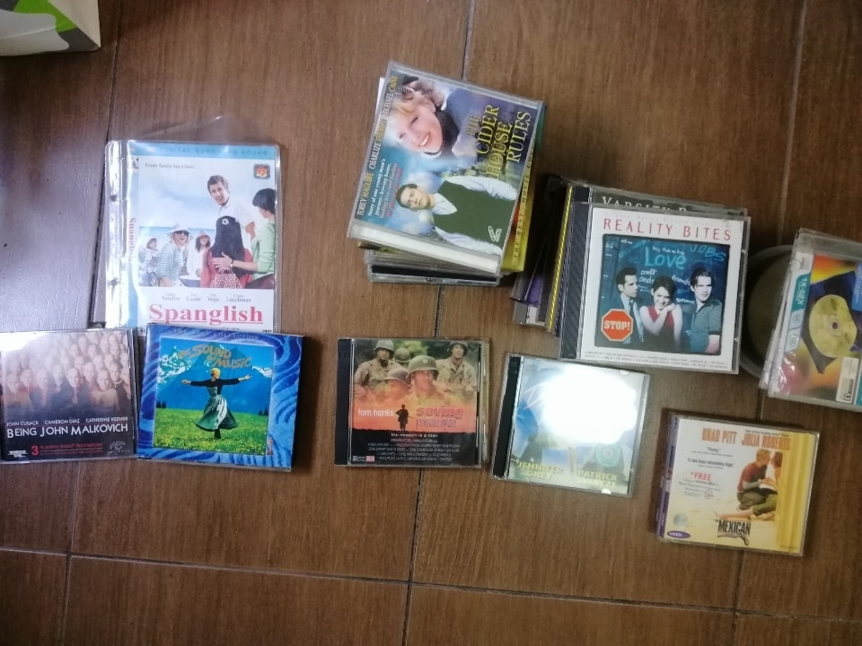 Lots of movie vcds, song albums, empty CDs and cases