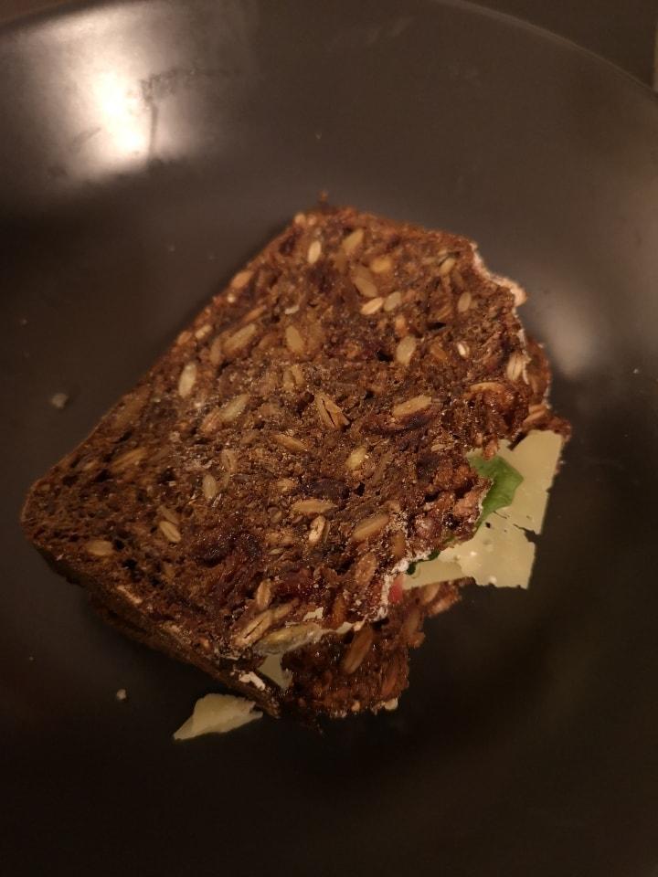 Fresh Danish bread sandwich with cheese, tomato ruccola