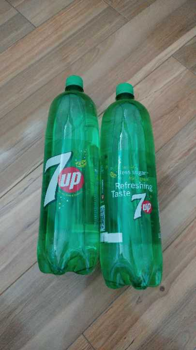 Two bottles of 7Up