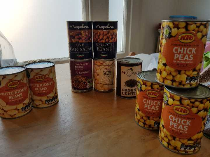 Cans of a variety of beans