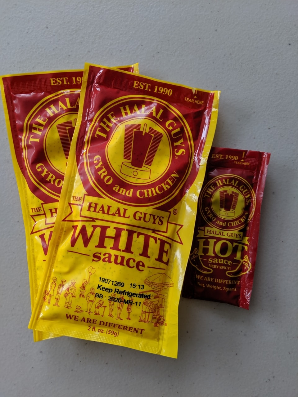 The Halal Guys White Sauce and Hot Sauce