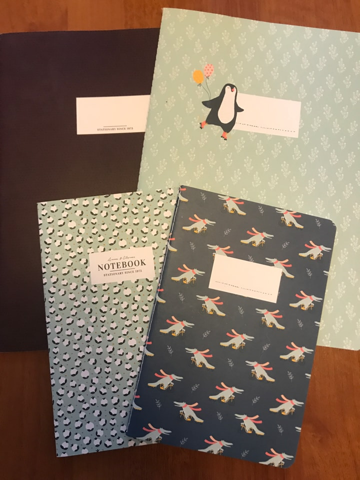 4 squared paper notebooks