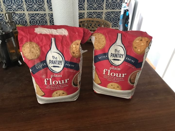 Two nearly full bags of plain flour