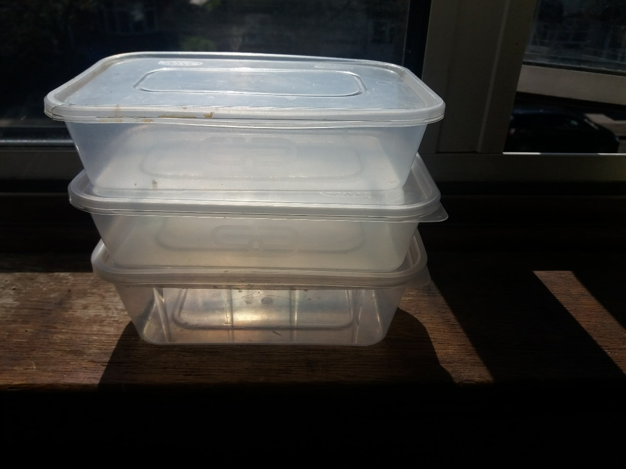 3 small plastic boxes
