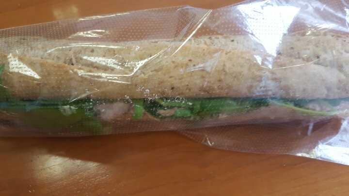 Tuna leaf salad brown baguette