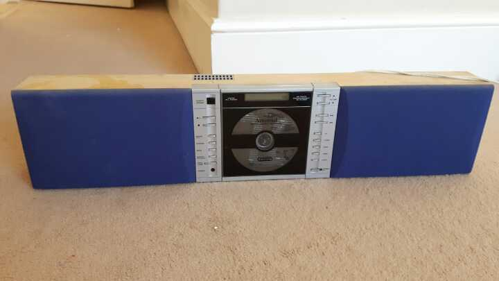 Cool 80s-90s CD player with builtin speakers.