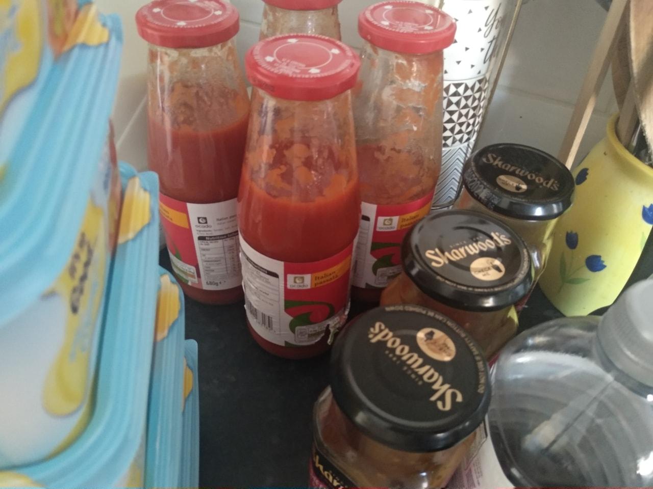 Opened bottles of passata