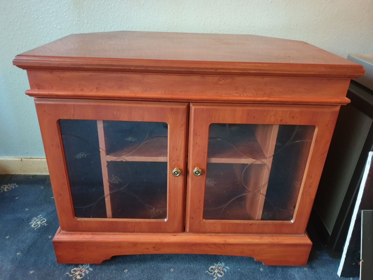 TV cabinet with glass front.