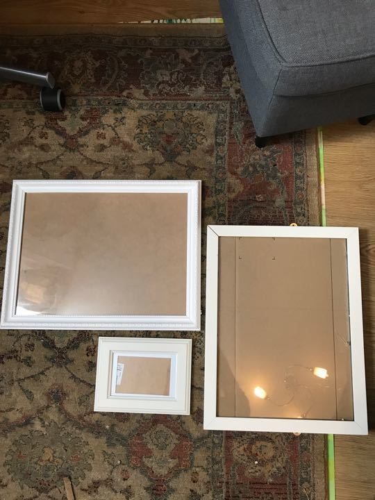 Assorted white picture frames