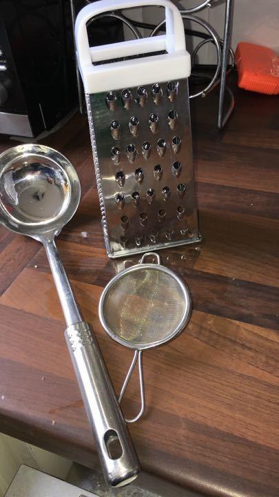 Kitchen laden, grater and tea strainer