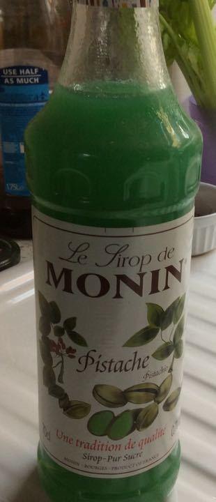 Almost full bottle of Monin pistachio syrup