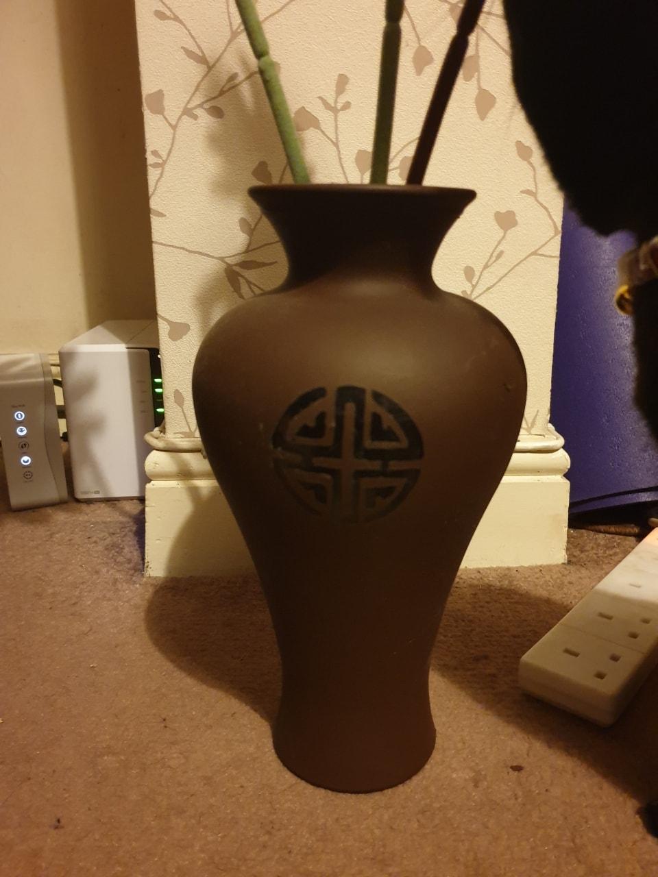 Brown vase with Celtic design
