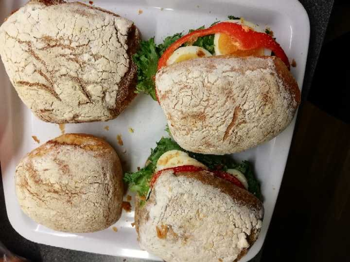 Two vegetarian sandwiches and 2 bread