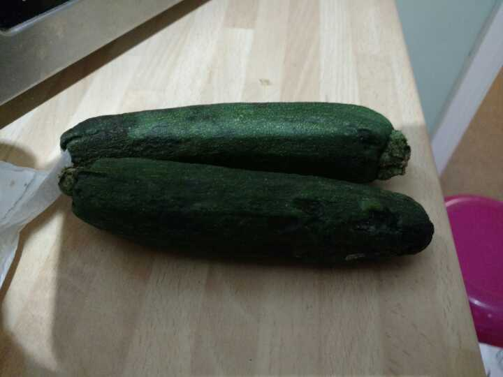 Two organic courgettes