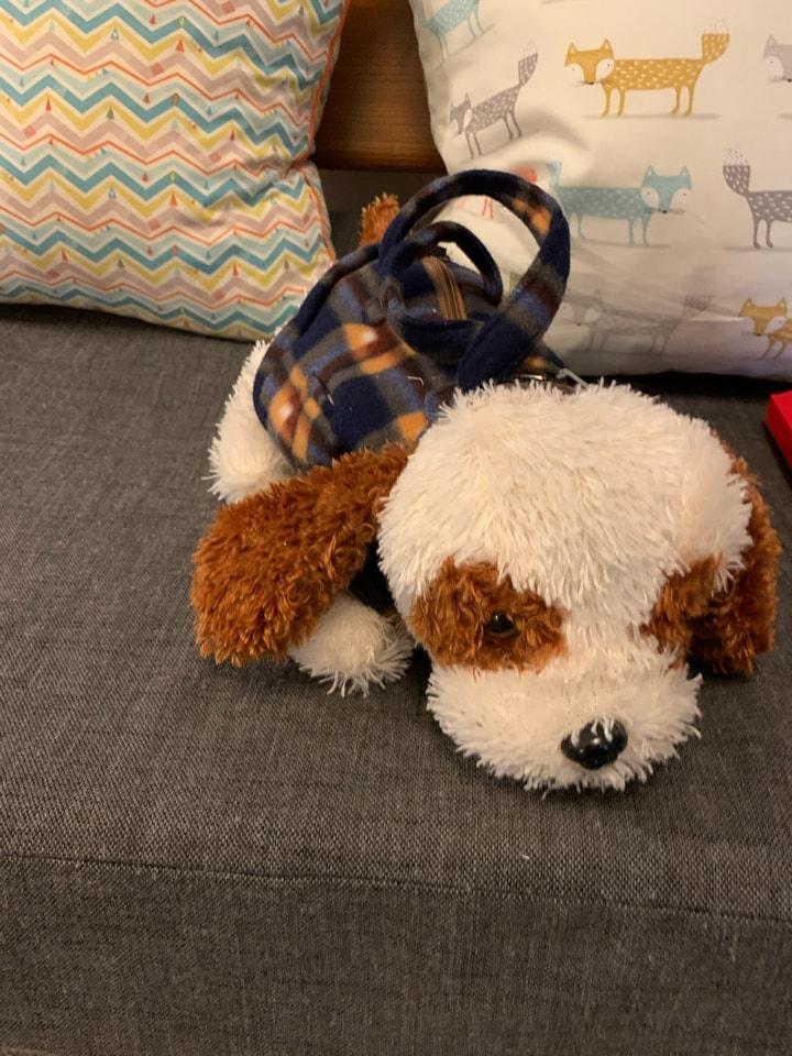 Cuddly dog hand bag