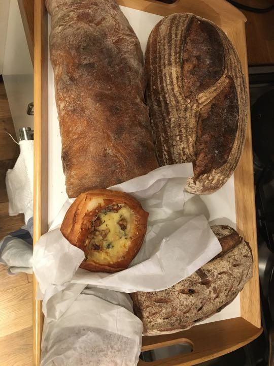 Artisan loaves, beef sandwich and cheese pastry