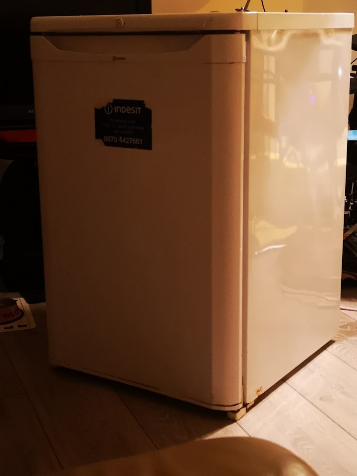 Small working but old fridge