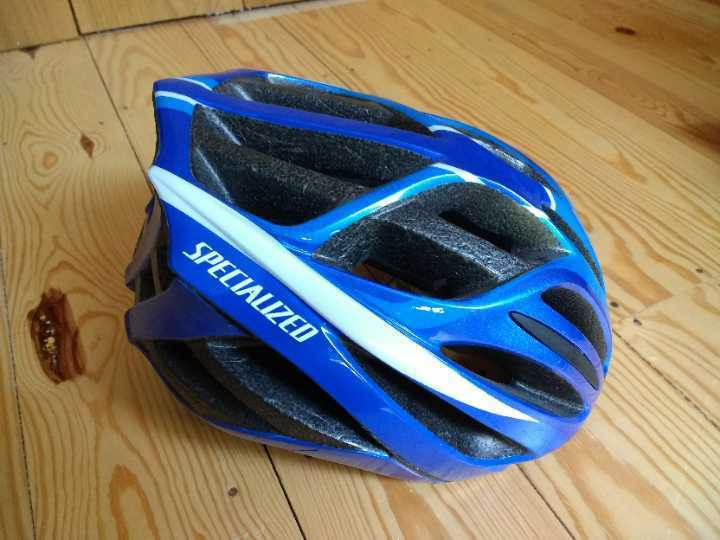 Two bicycle helmets. M/F. Specialized brand.