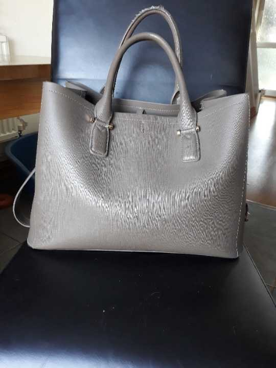 Large grey accessorize hand bag.
